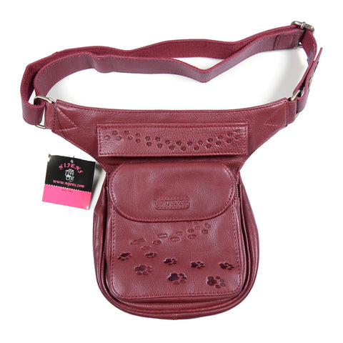 Dog walking bag made of red leather with embossed paw prints