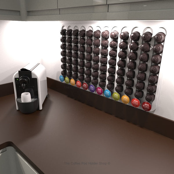 Dolce Gusto Pod Holder shown mounted on wall next to coffee maker