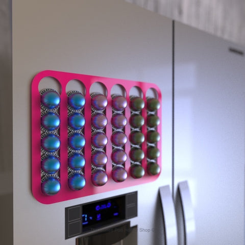 Magnetic Nespresso Vertuo capsule holder shown in pink on fridge door