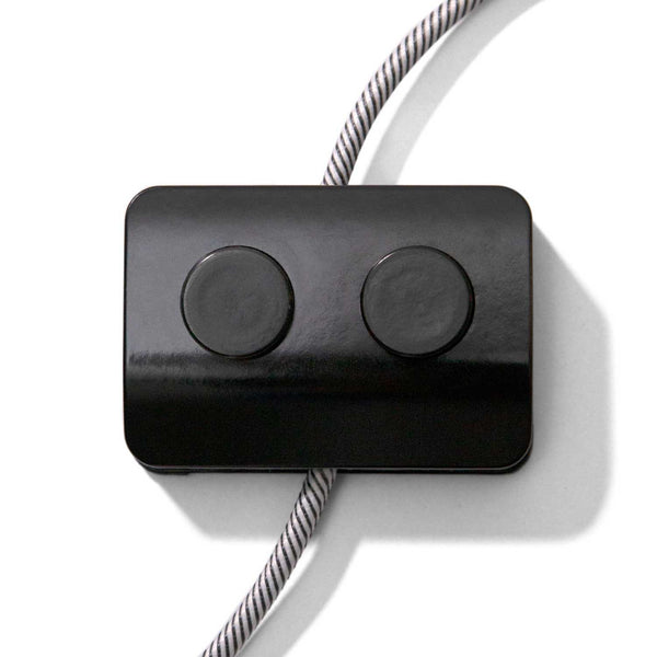 Double Single-Pole Foot Switch Black. Designed by Achille Castiglioni.