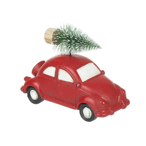 Red Car Carrying Christmas Tree