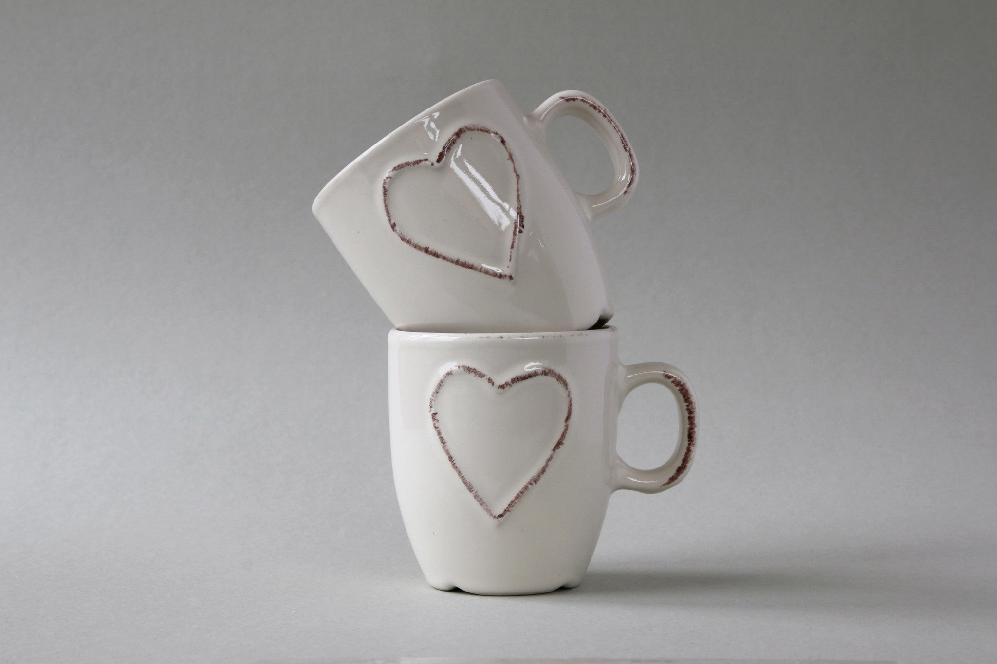 A pair of double espresso mugs in chalky white