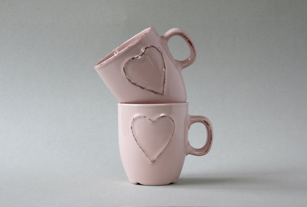 A pair of double espresso mugs in dusty pink