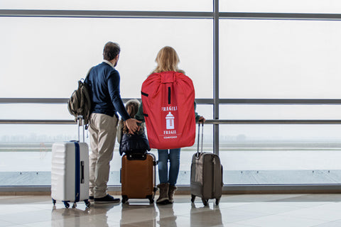 Family in airport with car seat backpack
