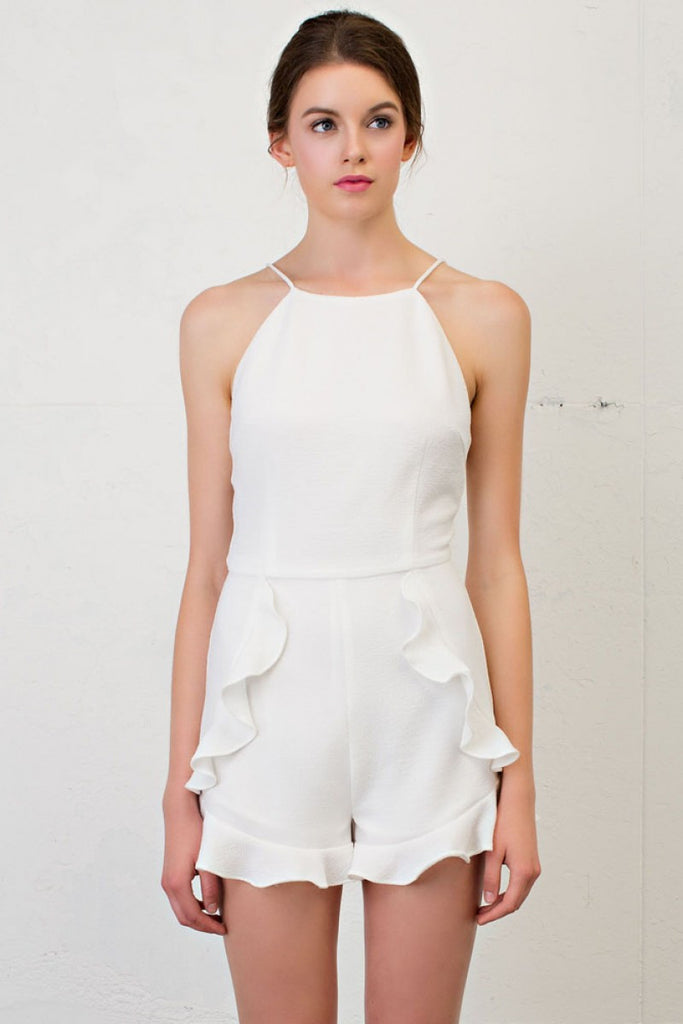 Spaghetti strap romper with cascading ruffled detail