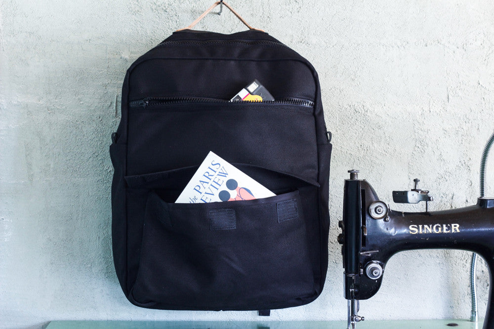 black waxed canvas zipper pack w/ laptop sleeve