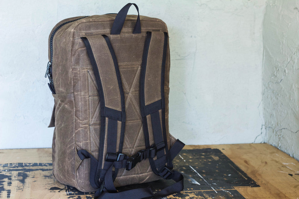 brown waxed canvas backpack w/ laptop sleeve