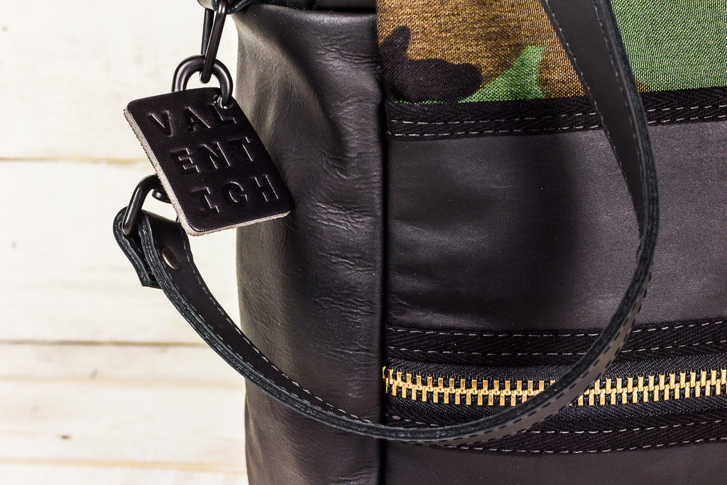 camo and black leather carryall w/ cross-body strap