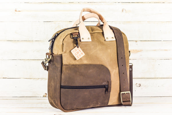 tan waxed canvas and brown leather carryall bag w/ cross-body strap