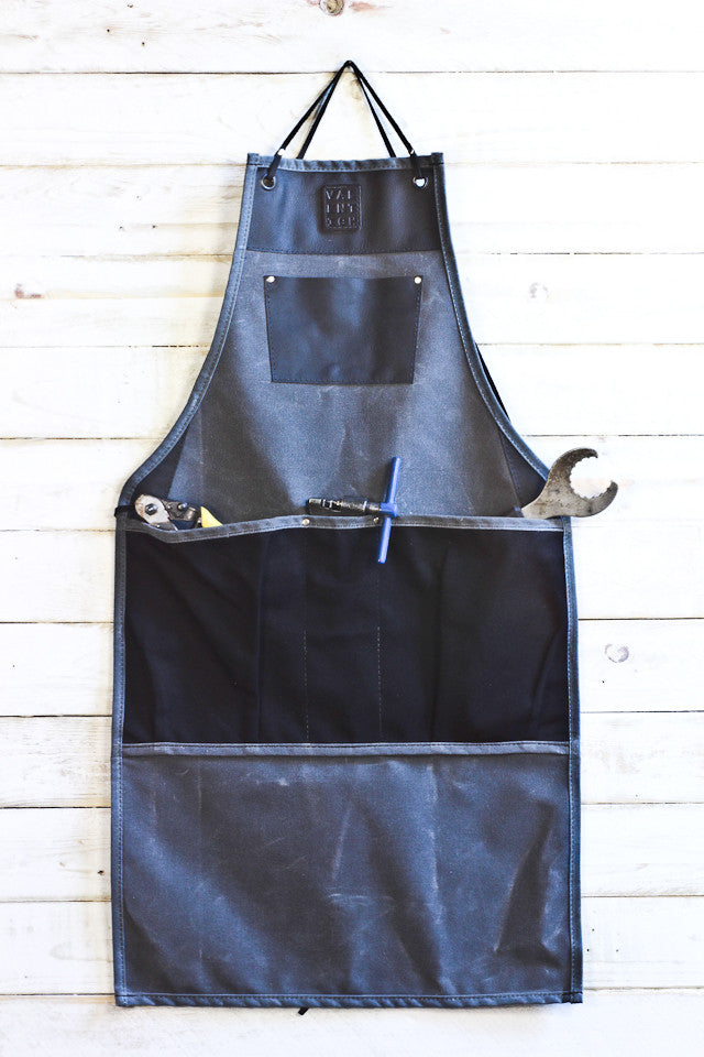 charcoal grey waxed canvas and black leather bib apron