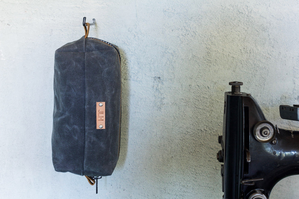 charcoal waxed canvas dopp kit with gold stitching and personalization