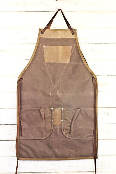 brown waxed canvas and leather bib utility apron