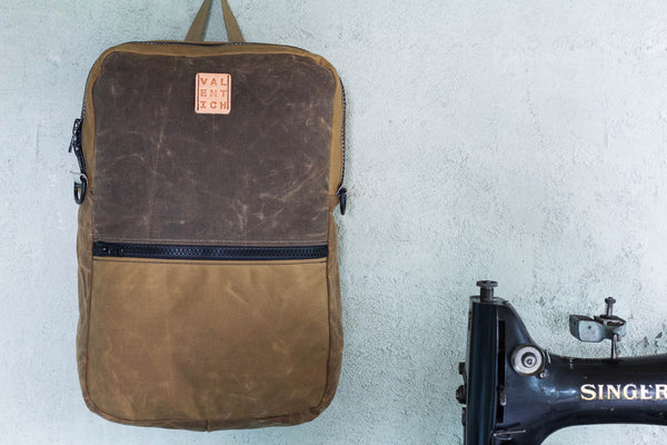 field tan waxed canvas backpack w/ cross-body strap