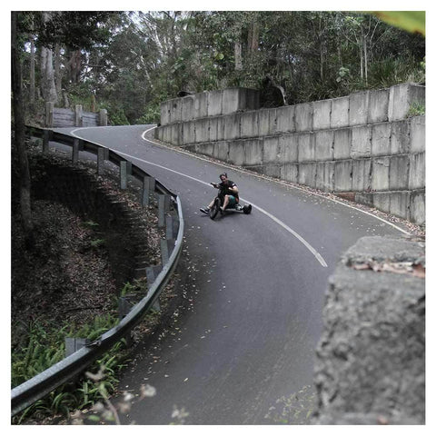 Image of fiik drifter guy riding down hill sliding