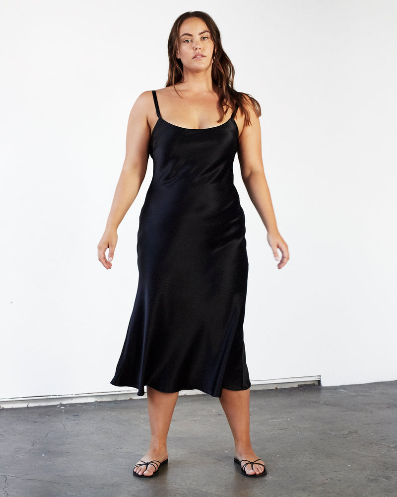 woman wearing round neck black silk slip dress
