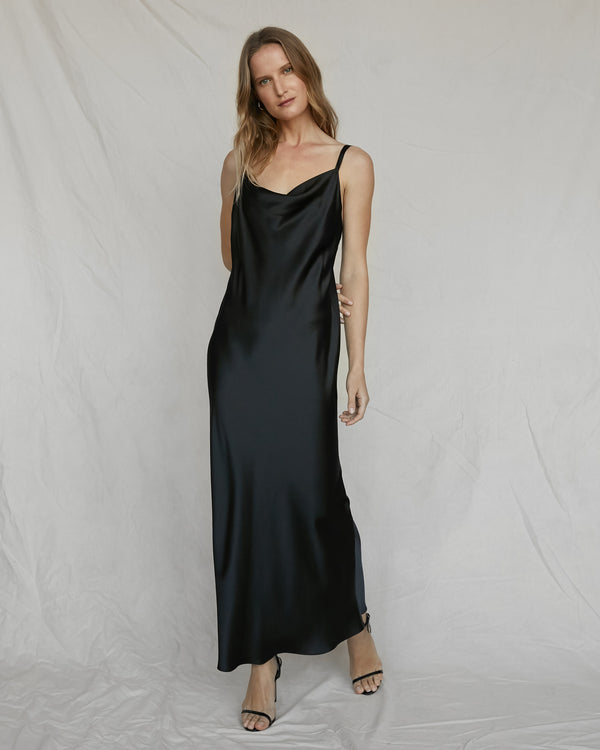 woman wearing long black silk slip dress
