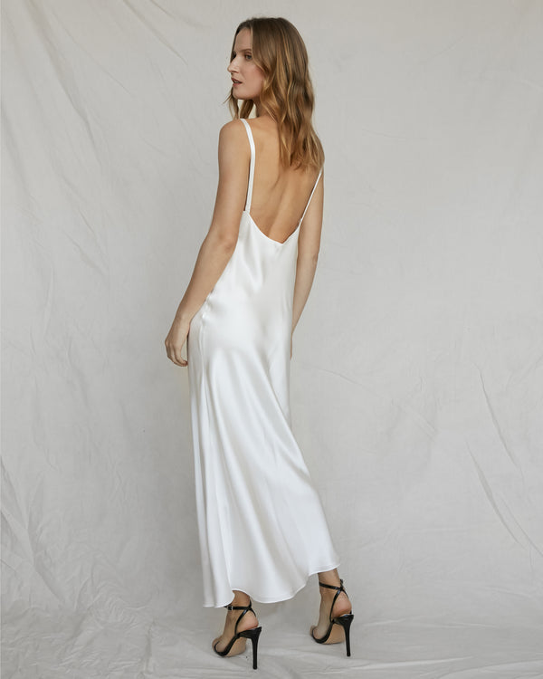 woman wearing long white silk slip dress