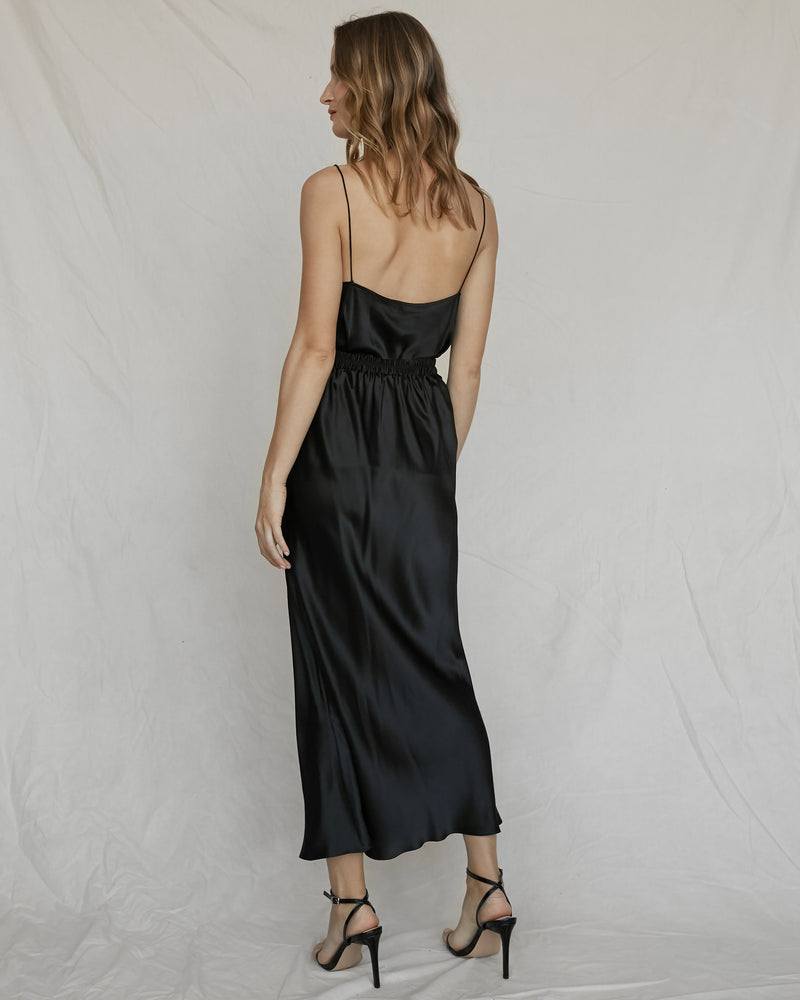 woman wearing black silk camisole and maxi skirt
