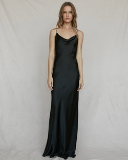 woman wearing floor length black silk slip dress