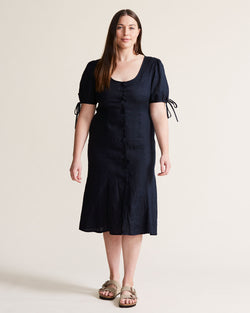 woman wearing navy linen dress
