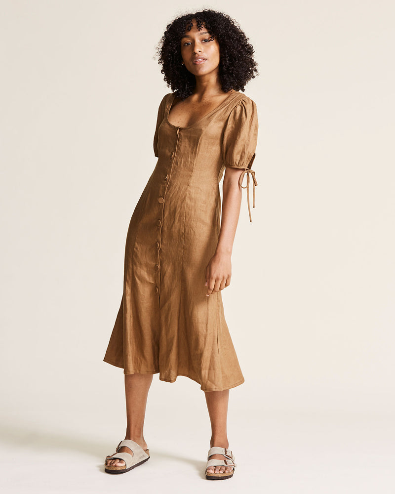 woman wearing mustard tan linen dress