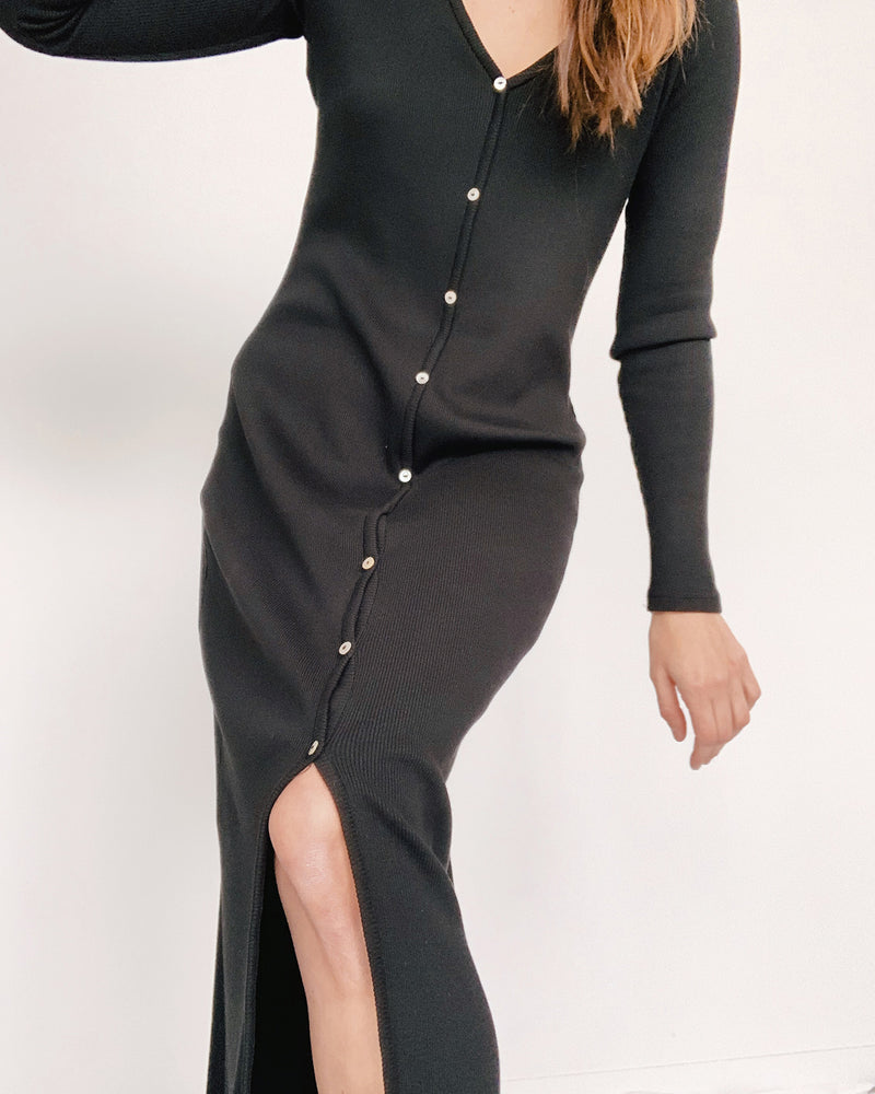 woman wearing long sleeve buttoned ribbed dress black