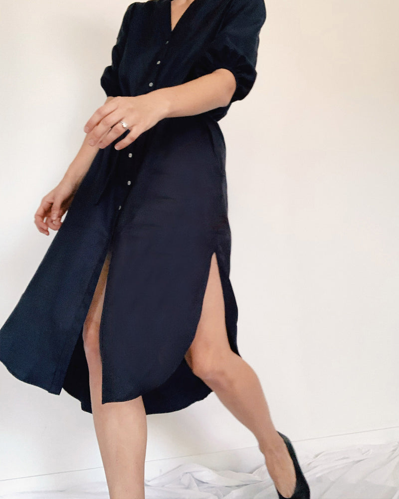 women wearing a midi navy shirt dress