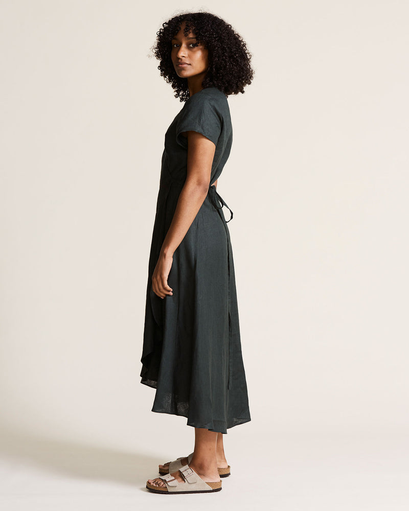 woman wearing green linen wrap dress