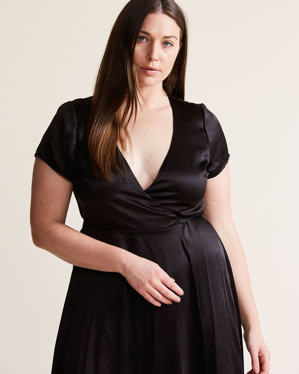 woman wearing black silk wrap dress