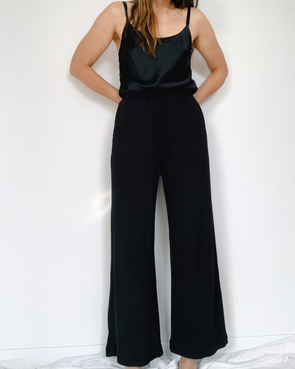 woman wearing long cotton rib pants black