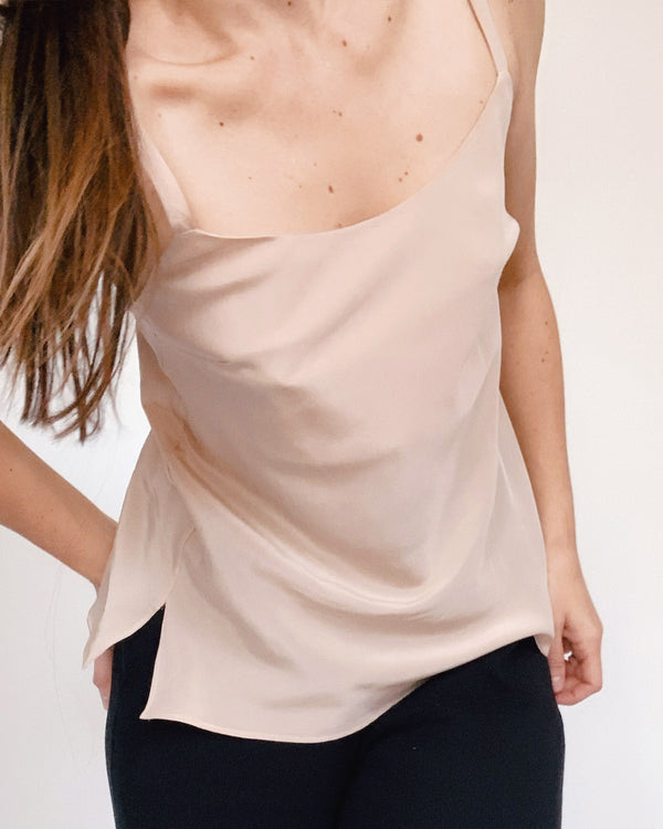 woman wearing neutral silk camisole top