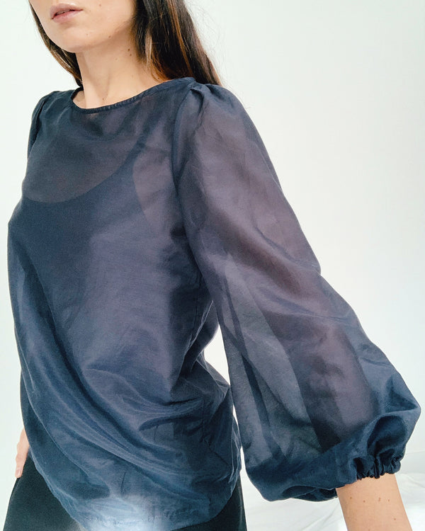 woman wearing long sleeve navy cotton silk blouse