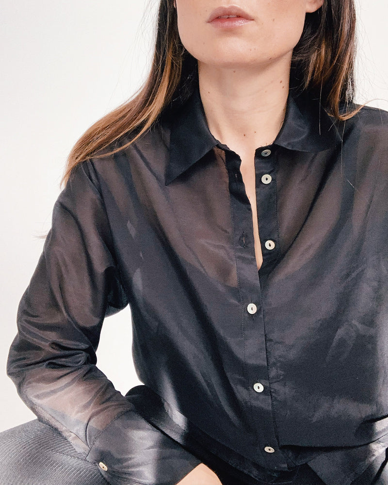 woman wearing long sleeve black cotton silk shirt