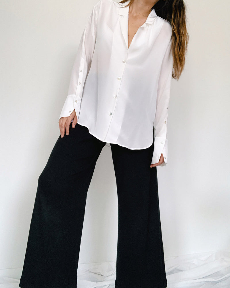 woman wearing long sleeve white silk shirt