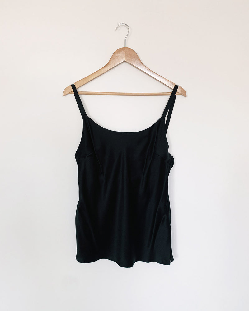 woman wearing round neck black silk camisole and cotton rib pants