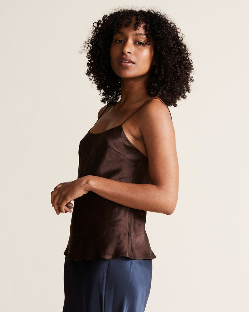woman wearing brown silk cami top