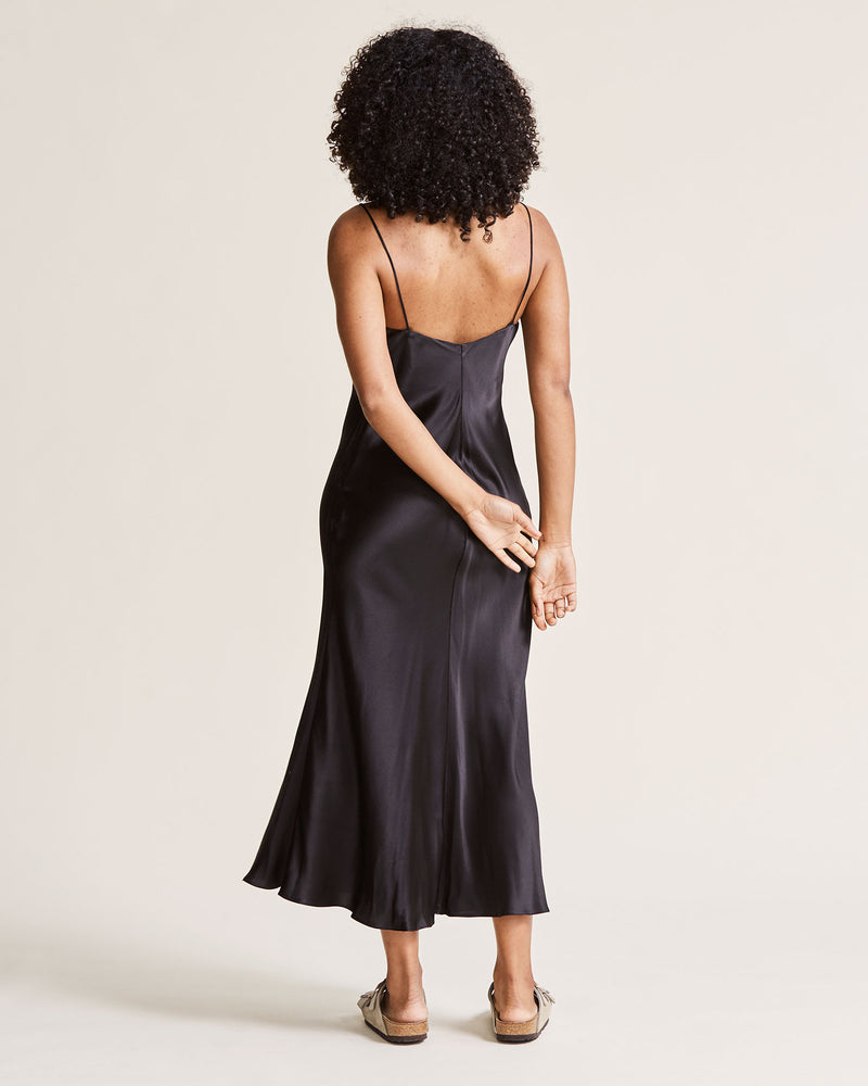 woman wearing black silk slip dress