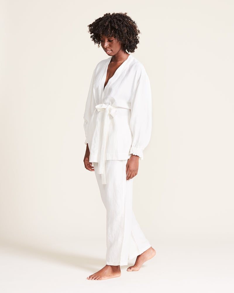 woman wearing short linen white robe