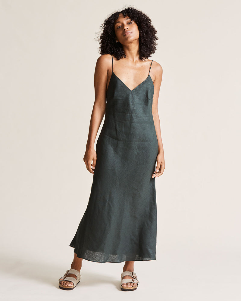 woman wearing bottle green linen dress
