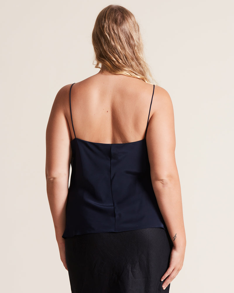 woman wearing navy silk cami top customised