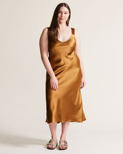 woman wearing copper rust silk slip dress