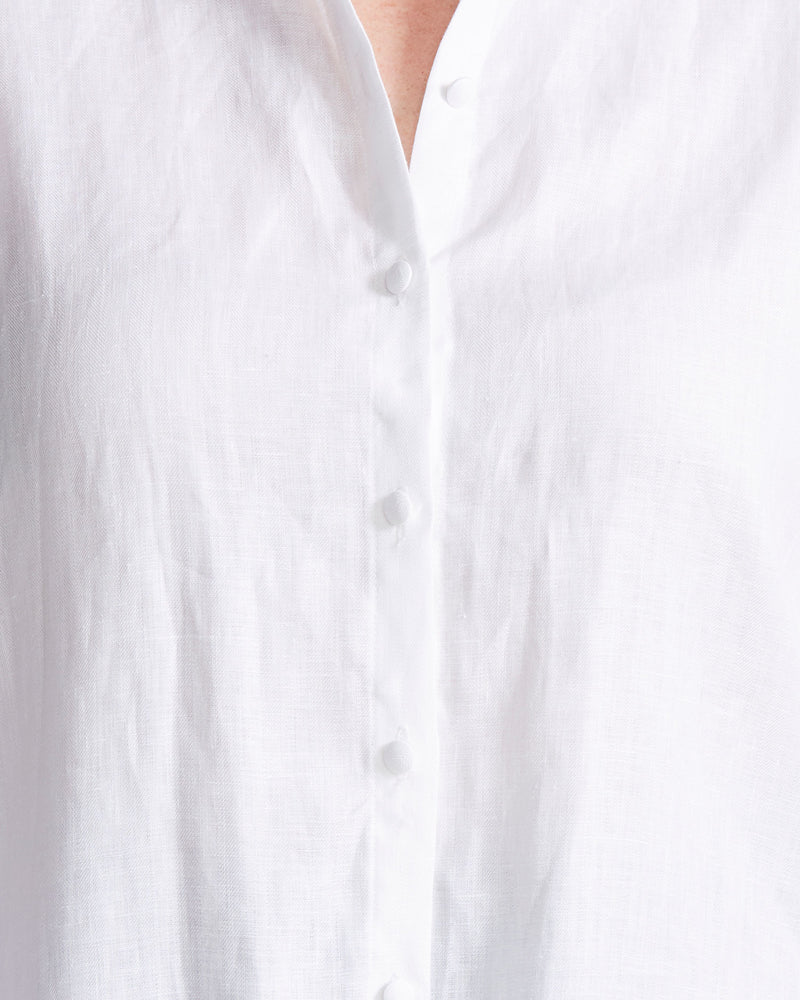 woman wearing white linen shirt