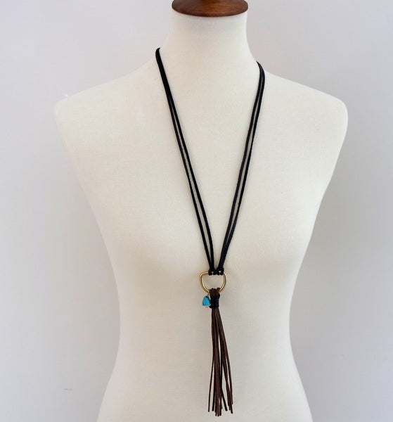 Brown suede tassel with real turquoise stone.