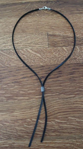 Buckskin leather lariat necklace with lobster closure at back.