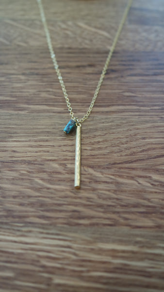 14k gold delicate chains, double charms and a real turquoise stone.