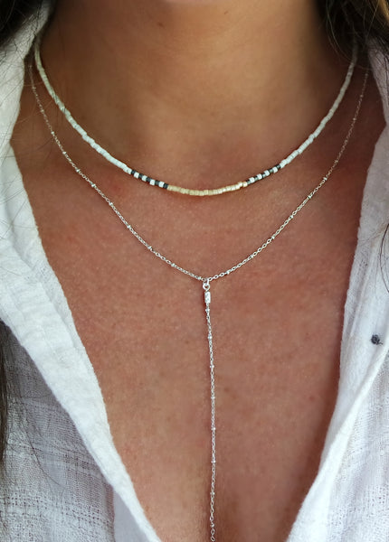 This delicate lariat necklace is created with Japanese Miyuki beads and textured sterling silver chain.