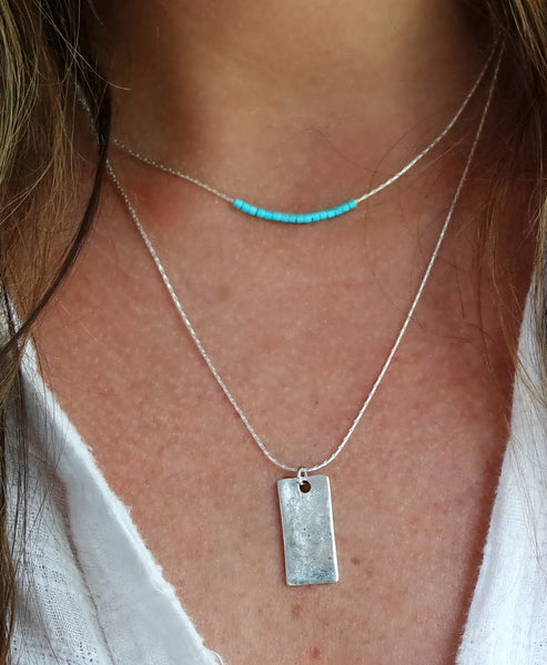 This delicate sterling silver snake chain duo has tiny blue-green Japanese Muraki beads and small bar charm.