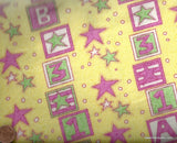 Yellow and pink blocks and stars flannel Camelot fabric