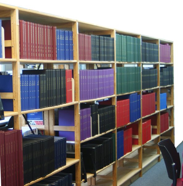 Volumes bound by The Bookbindery, in a library. Large number of binding colours.