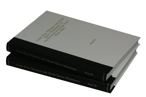 Thesis copies showing binding by The Bookbindery in a quarter bound style. (Spine in one bookbinding material and spine in another). This is one of the many options available at The Bookbindery.